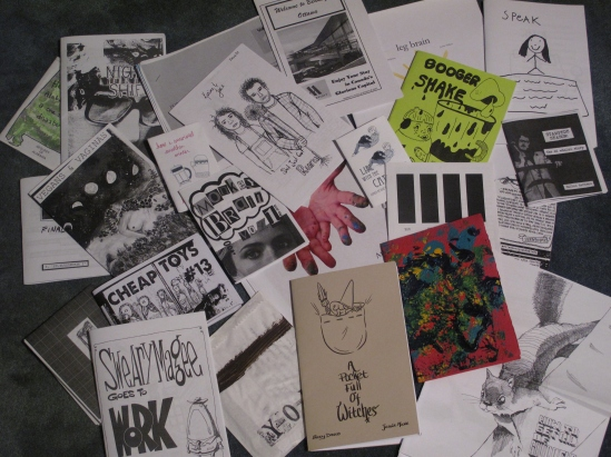 A zinester's booty from the Zine Off.